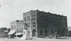 Doughboy Statue (1920) and Former Two and Three Story Brick Buildings on Southwest Corner of Center Avenue and 8th Street.