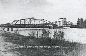 Former Steel Truss Bridge Crossing the Payette River at 6th Avenue. Note Flour Mill on the Far Side of the River.