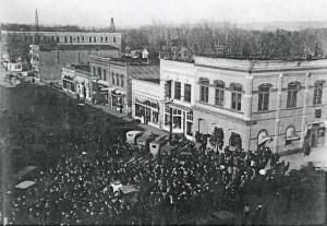 1920 Doughboy Statue Ceremony. Excellent Historic Photo Detailing the Original Storefronts of Buildings on 8th Street between Center Avenue and 1st Avenue North.